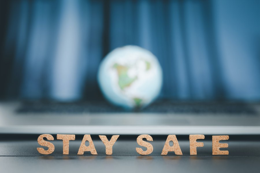 stay safe word with globe ball on blue tone background, coronavirus prevention concept